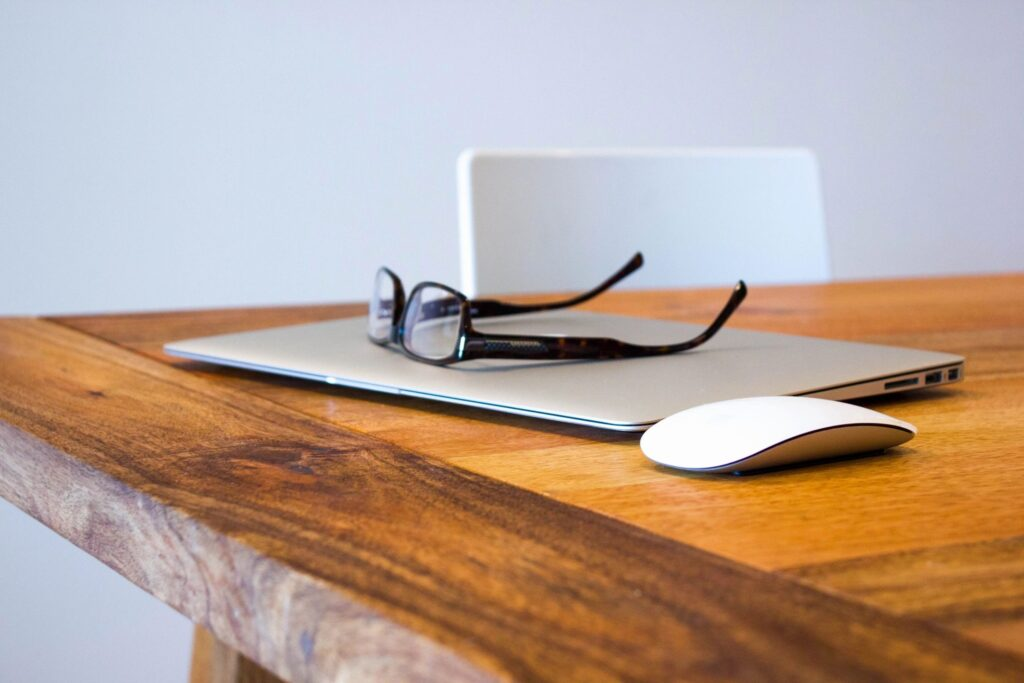Wordpress website pitfalls showing laptop and glasses