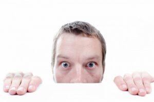 w3 design studio man's face looking over desktop