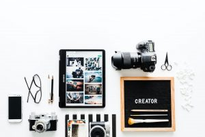 collage of photography equipment on white background to describe Website image sizes